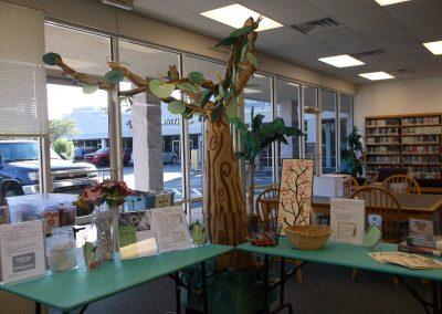 """Community members wrote limericks, haiku, and """"magnetic"""" poems on the leaves of our Poet-Tree."""